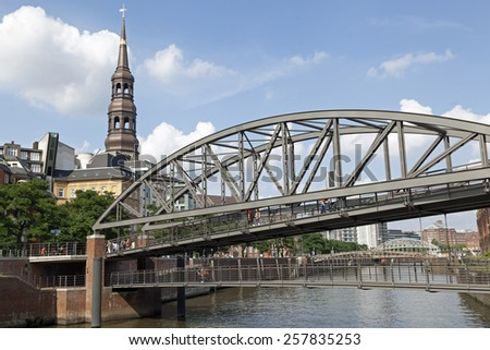 Bridge crossing the Zollkanal an Katharinenkirche in Hamburg, Germany - stock photo