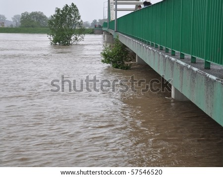 bridge drowned by the floods - stock photo