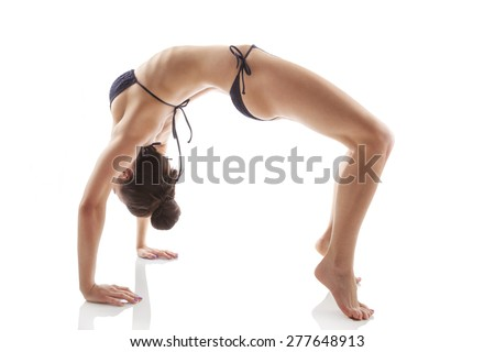 Bridge exercise. Asana. Yoga pose. Beautiful woman in 20s in bikini doing bridge exercise isolated on white background. Healthy lifestyle. - stock photo