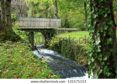 bridge in forest photographed close in autumn - stock photo