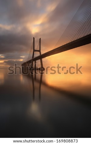 Bridge in Lisbon one of the greatest works of engineering and architecture of this century. - stock photo