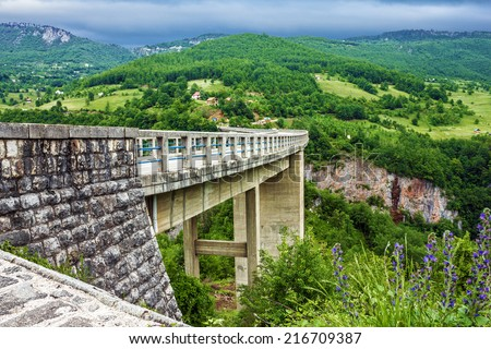 Bridge landscape Montenegro. Durdevica Tara arc bridge in the mountains. One of the highest automobile bridges in Europe. - stock photo