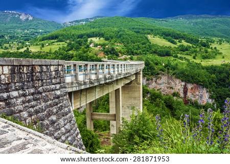 Bridge, mountain landscape, Montenegro. Durdevica Tara arc bridge in the mountains, One of the highest automobile bridges in Europe. - stock photo