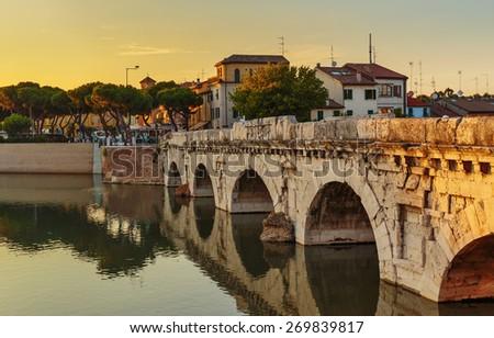 Bridge of Tiberius in Rimini at sunset, Italy.Toned - stock photo