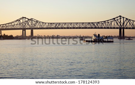 Bridge on Mississippi River in New Orleans, Louisiana - stock photo