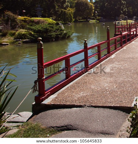 Bridge on the background of the pond in Japanese garden - stock photo