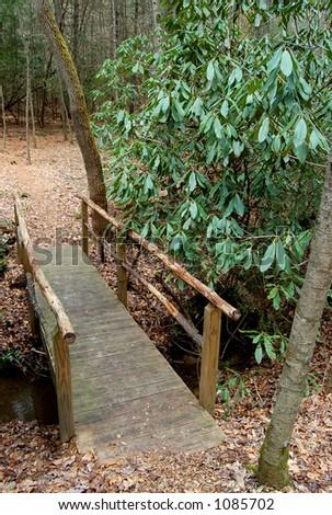 bridge over a creek - stock photo