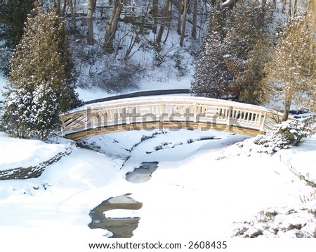bridge over a frozen river - stock photo