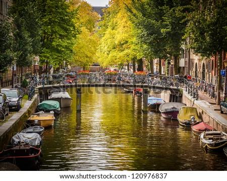Bridge over canal in Amsterdam - stock photo