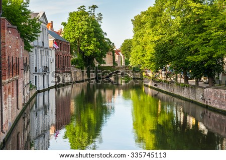Bridge over canal with traditional europe brickwall architecture in Bruges, Belgium - stock photo