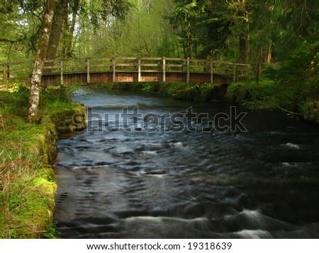 Bridge over Creek - stock photo