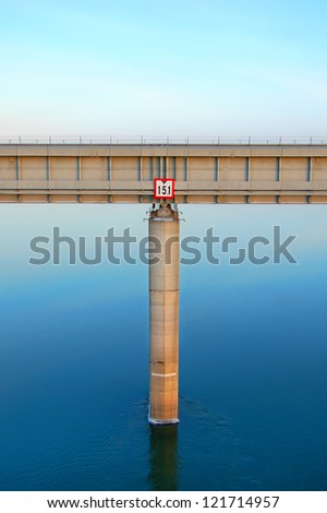 bridge over the river with the same support - stock photo