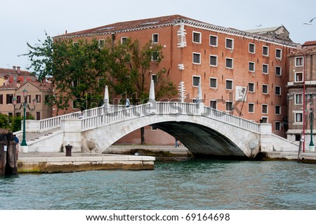 Bridge over the small canal in Venice, Italy - stock photo