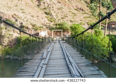 Bridge over Urubamba river in Pichingoto village in Sacred Valley of Incas, Peru - stock photo