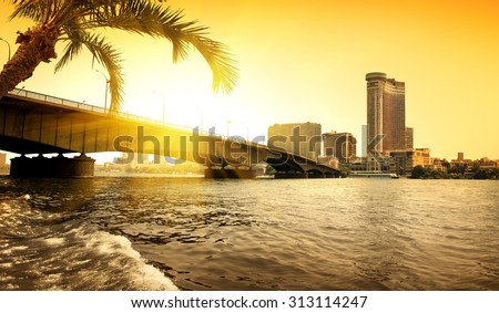 Bridge thropugh Nile in Cairo in the evening - stock photo