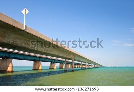 Bridges going to infinity. Seven mile bridge architecture landmark in Florida connecting Miami and Key West - stock photo