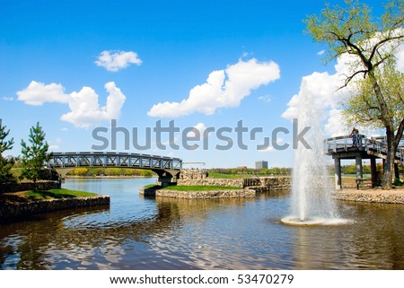 Bridges, little fountain and blue sky with clouds - stock photo