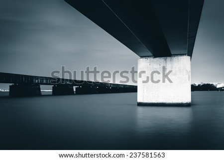 Bridges over the Potomac River at night, in Washington, DC. - stock photo