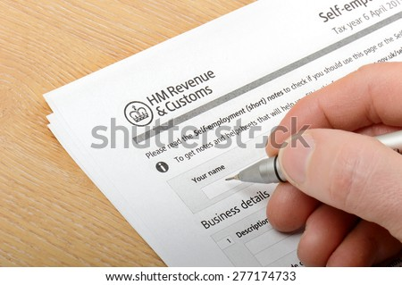 Bridgnorth, Shropshire/UK - April 02, 2015: Filling in a HM customs form on April 2, 2015 in Alveley, Shropshire, United Kingdom. - stock photo