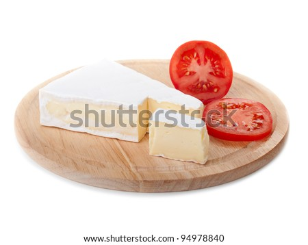brie cheese and tomato slice on wood plate isolated - stock photo