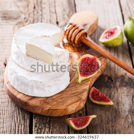 Brie cheese on a wooden Board with fresh Ingram and honey.selective focus. - stock photo
