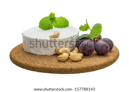 Brie cheese with grape, mint and cashew - stock photo