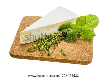 Brie cheese with mint and thyme - stock photo