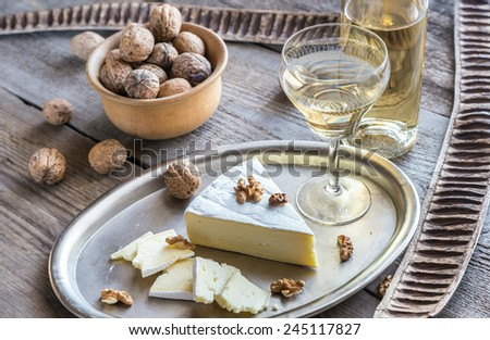 Brie cheese with nuts - stock photo