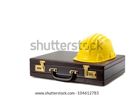 Briefcase with Safety Helmet - stock photo