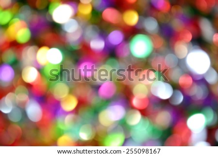 Bright and abstract blurred colorful rainbow background with shimmering glitter - stock photo