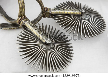 bright and beautiful Mexican spurs riding - stock photo