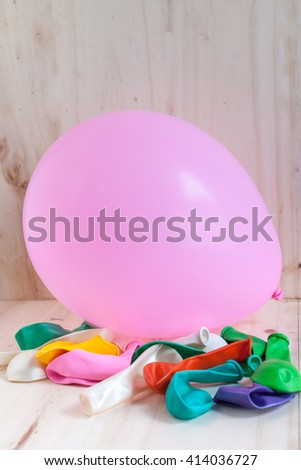 Bright and colorful balloons on the wood floor is used for illustration. - stock photo
