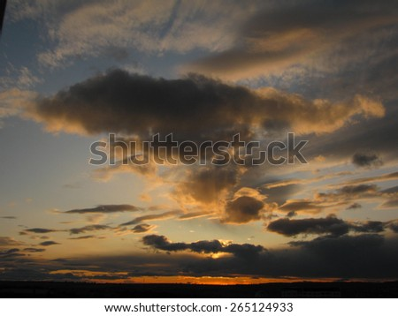 Bright and dark clouds looks like figures in sky - stock photo