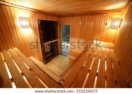 bright and hot interior of modern russian sauna - stock photo