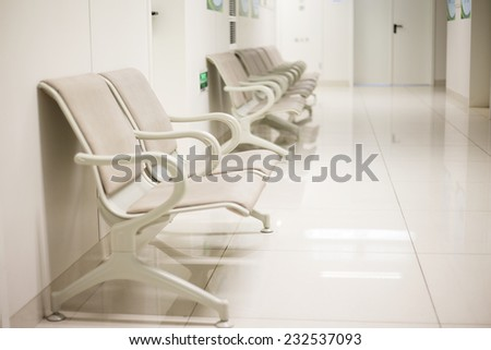 Bright and spacious hospital corridor seats - stock photo