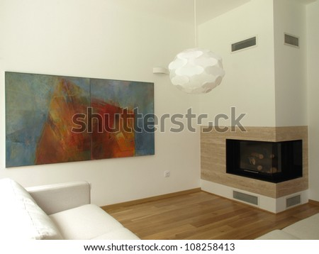 Bright and spacious living room with a fireplace - stock photo