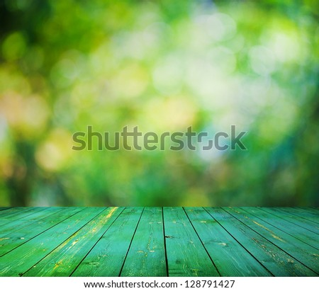 bright background, autumn bokeh and wooden floor - stock photo