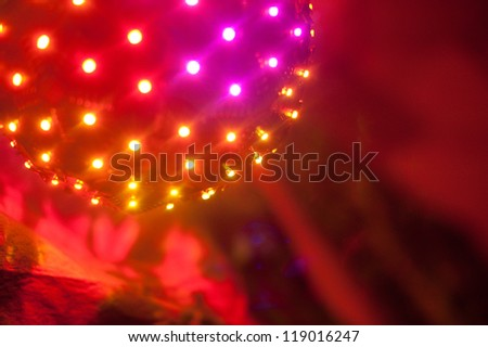 Bright ball of multicolored LED lights at a party - stock photo