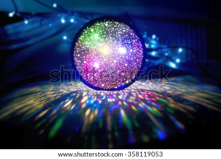 Bright ball of multicolored led lights in darkness. Colourful Glowing Lights.Luminous globe. Holiday background glittering sphere of light. - stock photo