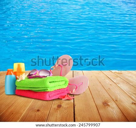 Bright beach accessories on sea background - stock photo