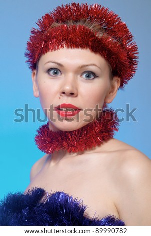 Bright beautiful woman with tinsel at her head - stock photo