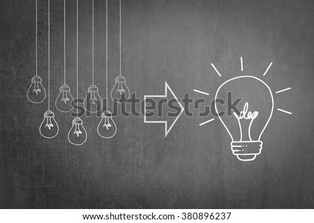 Bright big creative idea light bulb icon versus group of hanging small lightbulbs freehand doodle sketch drawing on black school chalkboard background Education IP Business teamwork brainstorm concept - stock photo