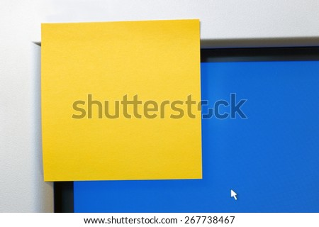 Bright Blank Sticky Note On Monitor Of Computer Ready for Copy Space - stock photo