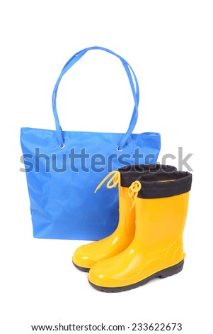 bright blue bag and yellow rubber shoes - stock photo