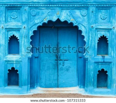 Bright blue doorway in India - stock photo