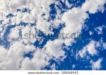 Bright blue sky and clouds - stock photo