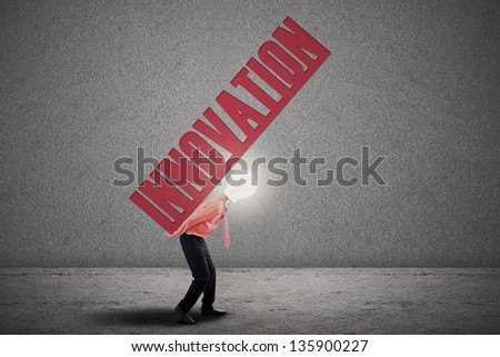 Bright businessman with light bulb head carry innovation letter - stock photo