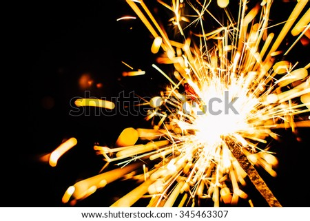 Bright Christmas  sparkler closeup on a black background soft focus - stock photo