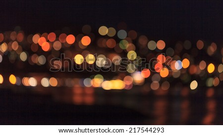 bright city lights background over the water  - stock photo