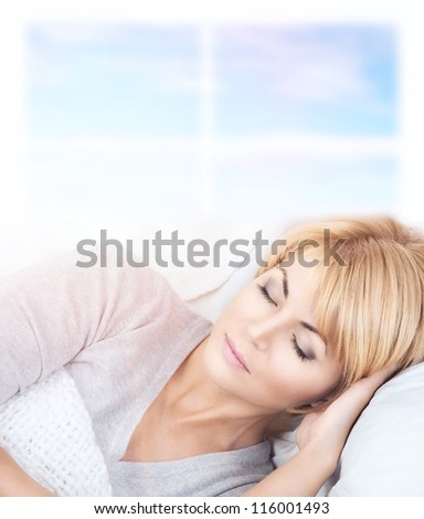 bright closeup picture of beautiful sleeping woman. - stock photo